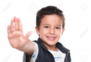 12806611-Happy-child-making-a-stop-signal-with-hand-Stock-Photo-boy